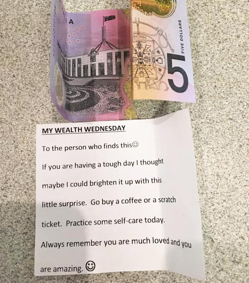 Pictured id a $5 note and kind message left in a random Woolworths box of nappies a Brisbane mum found.