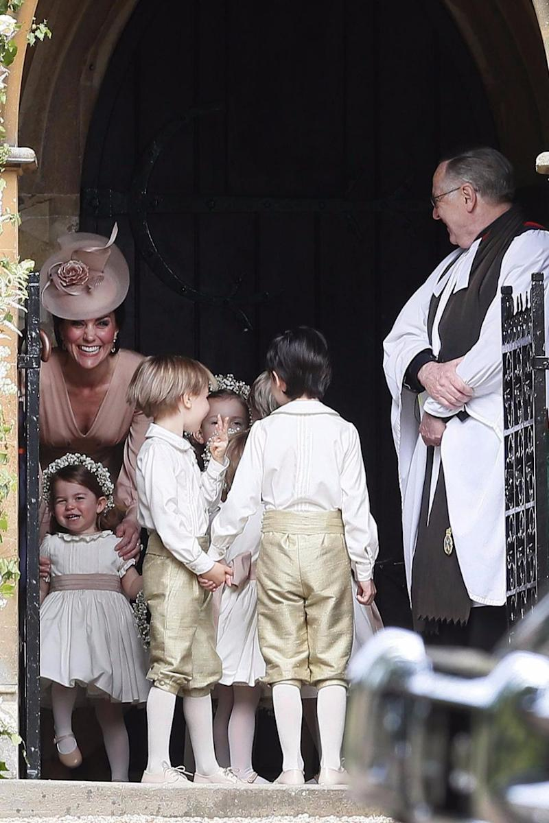 Kate couldn't hide an enormous grin when she first saw her sister arrive at the church. Source: Getty