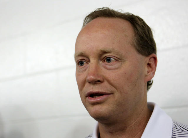 Atlanta Hawks coach Mike Budenholzer talks to reporters before an NBA preseason basketball game against the Miami Heat, Monday, Oct. 7, 2013, in Miami. (AP Photo/Alan Diaz)