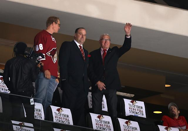 GLENDALE, AZ - APRIL 13: Phoenix Coyotes Owners, Anthony LeBlanc (C) and W. R. Dutton (R) wave to fans during the NHL game against the Dallas Stars at Jobing.com Arena on April 13, 2014 in Glendale, Arizona. The Coyotes defeated the Stars 1-0. (Photo by Christian Petersen/Getty Images)
