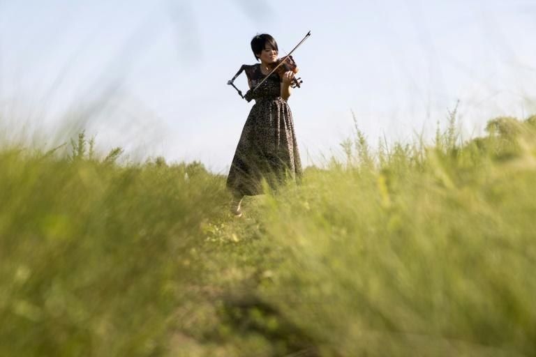 Manami Ito turned to the violin for the first time since childhood after her accident (AFP/Yuki IWAMURA)