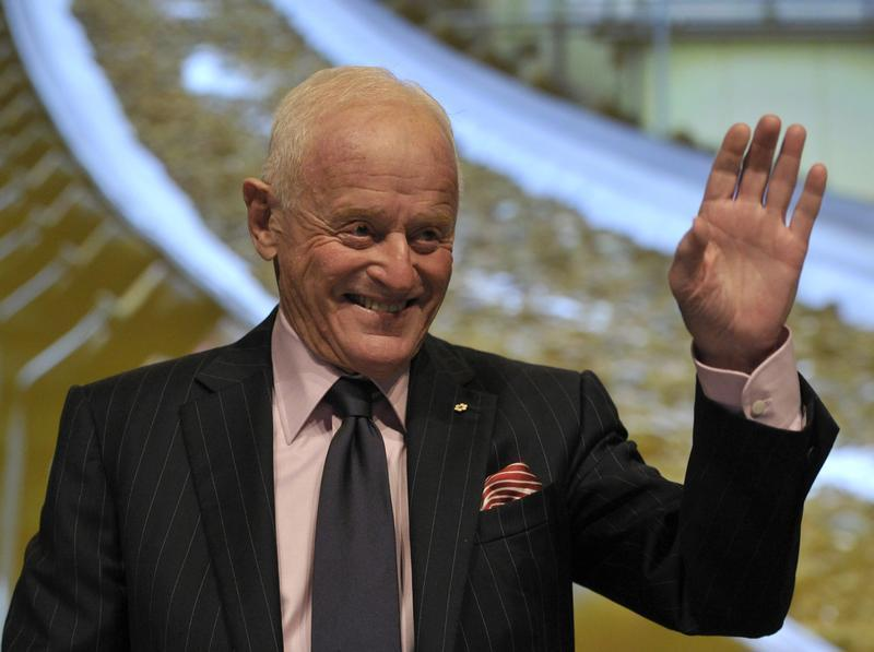 Barrick Gold Corporation Chairman Peter Munk waves during the annual general meeting of shareholders in Toronto