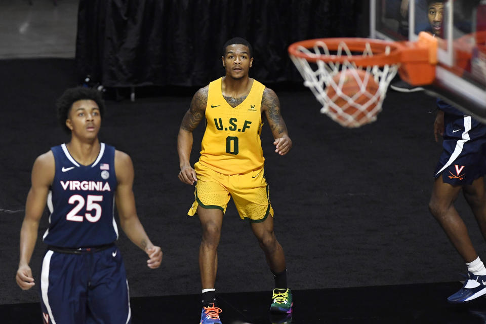 San Francisco's Khalil Shabazz, center, watches his 3-point basket go in against Virginia. (AP Photo/Jessica Hill)