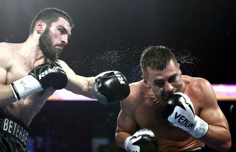 PHILADELPHIA, UNITED STATES - OCTOBER 19, 2019: IBF belt-holder Artur Beterbiev of Russia (L) and WBC titlist Oleksandr Gvozdyk of Ukraine compete in a light heavyweight world title unification boxing fight at the Liacouras Center in Philadelphia, Pennsylvania, United States. Valery Sharifulin/TASS (Photo by Valery Sharifulin\TASS via Getty Images)