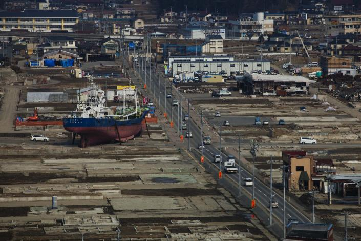 In this Feb. 23, 2012, file photo, a ship sits in a destroyed residential neighborhood in Kesennuma, Miyagi Prefecture, northeastern Japan, almost a year after an earthquake and tsunami ravaged the country's coastline. (AP Photo/David Guttenfelder, File)