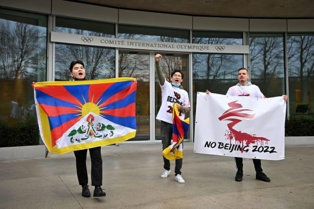 Activists protest against the 2022 Beijing Olympics outside of IOC headquarters in February. While some have been calling to move the Games from China due to reported human rights abuses, that may not be a realistic option, say veteran Olympics organizers.