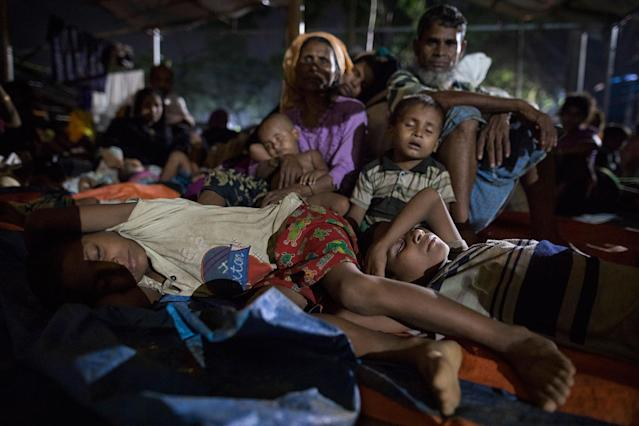 <p>New Rohingya arrivals from Myanmar pack an overcrowded area trying to get some rest while they are waiting for shelter September 29 in Kutupalong, Bangladesh. (Photograph by Paula Bronstein/Getty Images) </p>