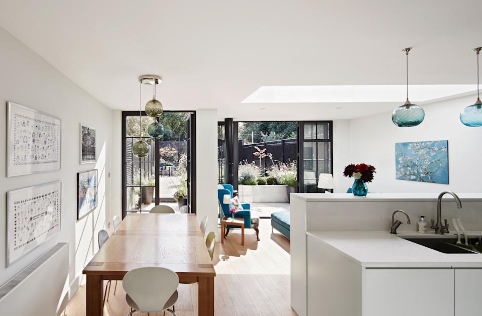 large white kitchen extension with contemporary finish by mulroy architects