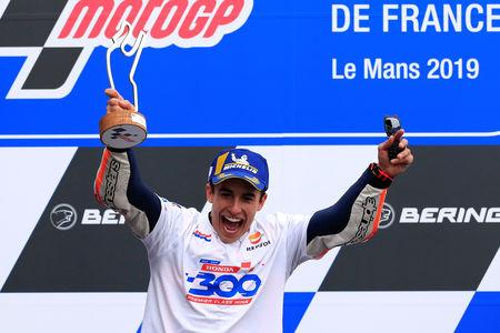 MotoGP - French Grand Prix - Circuit Bugatti, Le Mans, France - May 19, 2019   Repsol Honda's Marc Marquez celebrates winning the race on the podium with the trophy   REUTERS/Gonzalo Fuentes