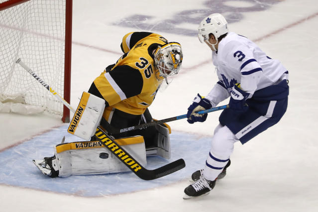Pittsburgh Penguins goaltender Tristan Jarry (35) stops a break away by Toronto Maple Leafs' Justin Holl during the first period of an NHL hockey game in Pittsburgh, Saturday, Nov. 16, 2019. (AP Photo/Gene J. Puskar)