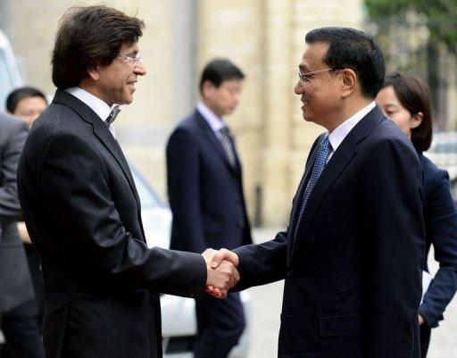 Belgian Prime Minister Elio Di Rupo (L) and Chinese Vice-Prime Minister Li Keqiang (R) shake hands at The Egmont Palace