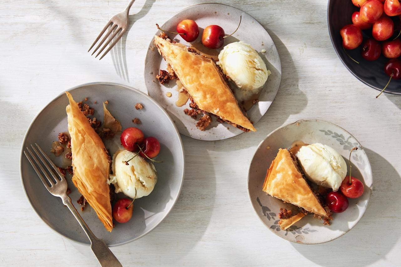 """The honey-bourbon syrup is the star of this baklava. Serve it with cherries and vanilla ice cream for a decadent summer dessert. <a href=""""https://www.epicurious.com/recipes/food/views/pecan-bourbon-baklava?mbid=synd_yahoo_rss"""">See recipe.</a>"""
