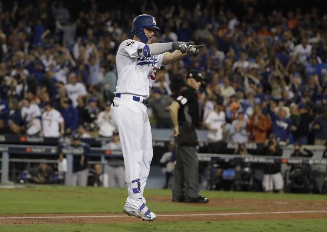 Joc Pederson celebrates after hitting a home run during the seventh inning of Game 6 of baseball's World Series against the Houston Astros Tuesday, Oct. 31, 2017, in Los Angeles. (AP Photo)