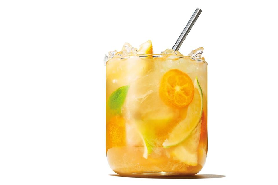"""The balance of tartness and bitterness and sweetness in this rum drink comes from muddling lime, brown sugar, kumquat, and white grapefruit to release fresh juices and fragrant citrus oils. <a href=""""https://www.epicurious.com/recipes/food/views/mixed-citrus-daiquiri?mbid=synd_yahoo_rss"""" rel=""""nofollow noopener"""" target=""""_blank"""" data-ylk=""""slk:See recipe."""" class=""""link rapid-noclick-resp"""">See recipe.</a>"""