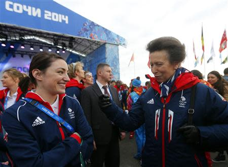 Britan's Princess Anne talks with the figure skater Jenna McCorkell during the welcoming ceremony for the British Olympic team in the Athletes Village at the Olympic Park ahead of the 2014 Winter Olympic Games in Sochi February 6, 2014. REUTERS/Laszlo Balogh