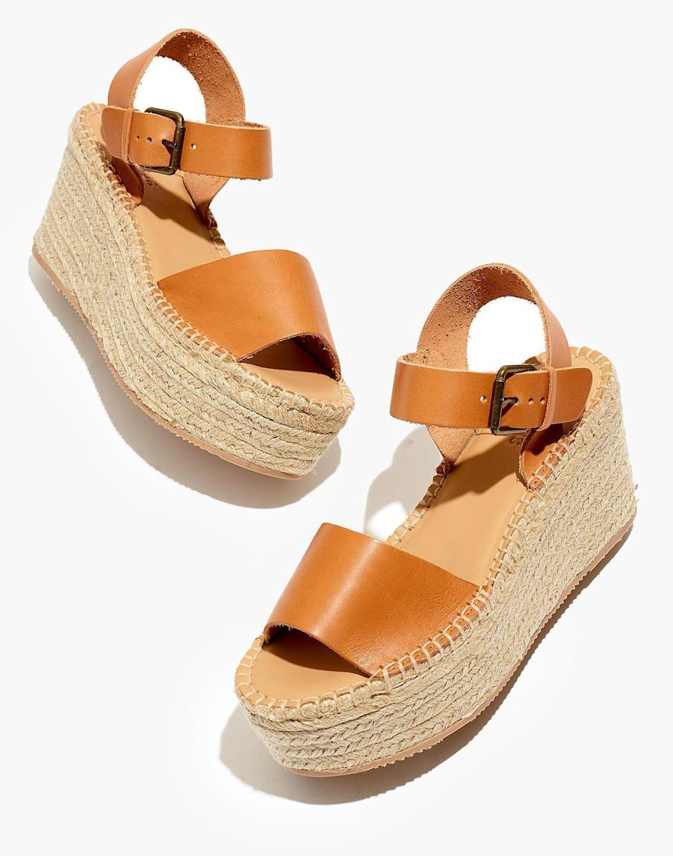 """<p><strong>Soludos</strong></p><p>madewell.com</p><p><strong>$149.00</strong></p><p><a href=""""https://go.redirectingat.com?id=74968X1596630&url=https%3A%2F%2Fwww.madewell.com%2Fsoludosreg%253B-minorca-platform-espadrille-sandals-99105412031.html&sref=https%3A%2F%2Fwww.cosmopolitan.com%2Fstyle-beauty%2Ffashion%2Fg35017315%2F2021-shoe-trends%2F"""" rel=""""nofollow noopener"""" target=""""_blank"""" data-ylk=""""slk:Shop Now"""" class=""""link rapid-noclick-resp"""">Shop Now</a></p><p>These sandals with a bright dress will make a super cute outfit this summer. </p>"""
