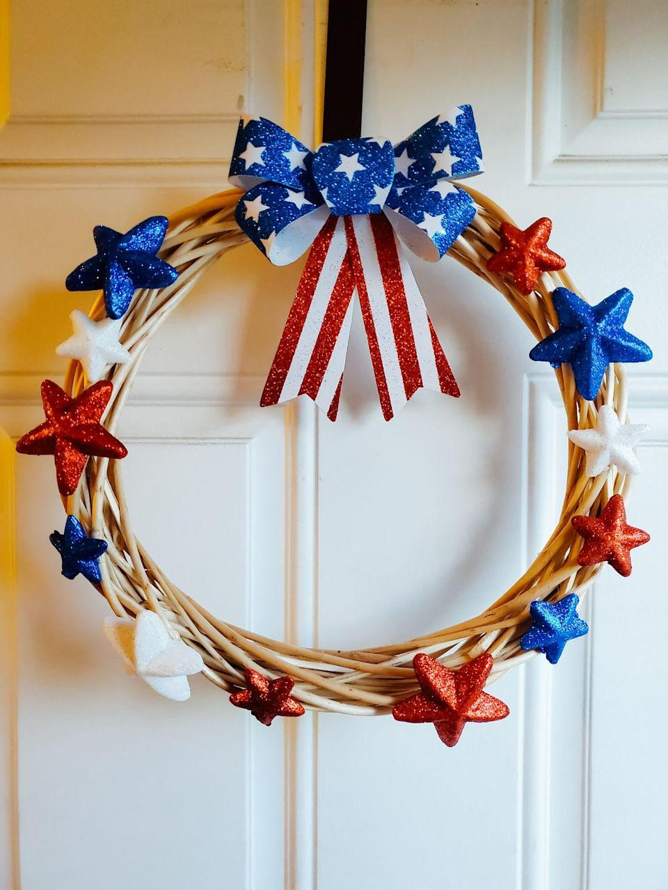 """<p>Add some sparkle to the front door with this willow wreath, hot glued with glittering red, white, and blue stars and topped off with a shimmery patriotic ribbon. </p><p><strong>Get the tutorial at <a href=""""https://goodlifedetroit.com/diy-fourth-of-july-wreaths-craft-idea/"""" rel=""""nofollow noopener"""" target=""""_blank"""" data-ylk=""""slk:Good Life Detroit"""" class=""""link rapid-noclick-resp"""">Good Life Detroit</a>. </strong></p><p><strong><a class=""""link rapid-noclick-resp"""" href=""""https://www.amazon.com/Patriotic-Foam-Glitter-Scatters-Fourth/dp/B07S2YT8RJ/ref=sr_1_2?dchild=1&keywords=foam+scatter&qid=1622038415&sr=8-2&tag=syn-yahoo-20&ascsubtag=%5Bartid%7C10050.g.4464%5Bsrc%7Cyahoo-us"""" rel=""""nofollow noopener"""" target=""""_blank"""" data-ylk=""""slk:SHOP FOAM GLITTER STARS"""">SHOP FOAM GLITTER STARS </a><br></strong></p>"""
