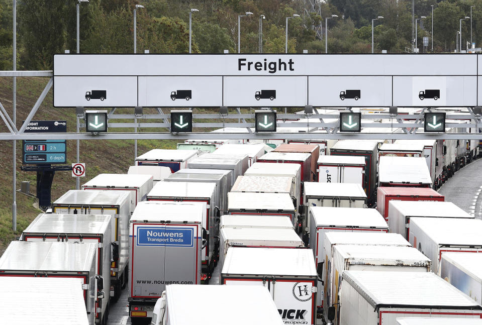 A view of lorries queuing for the Eurotunnel in Folkestone, Kent, England, Friday, Sept. 25, 2020, as the government develops the 27-acre site near Ashford into a post-Brexit lorry park as it gears up to leave the EU at the end of the year. (Gareth Fuller/PA via AP)