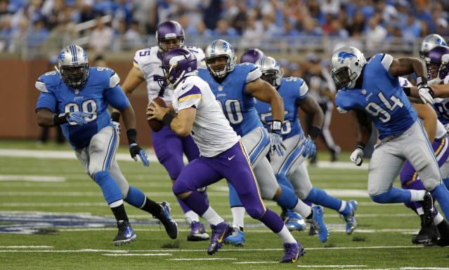 Minnesota Vikings quarterback Christian Ponder (7) is chased by Detroit Lions defensive tackle Nick Fairley (98), defensive tackle Ndamukong Suh (90) and defensive end Ezekiel Ansah (94) during the fourth quarter of an NFL football game at Ford Field in Detroit, Sunday, Sept. 8, 2013. (AP Photo/Duane Burleson)