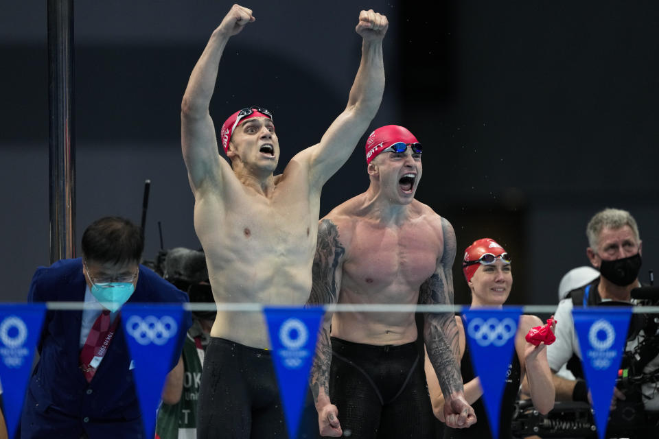 James Guy, of Britain, and teammate Adam Peaty celebrate winning the gold medal in the mixed 4x100-meter medley relay final at the 2020 Summer Olympics, Saturday, July 31, 2021, in Tokyo, Japan. (AP Photo/Jae C. Hong)