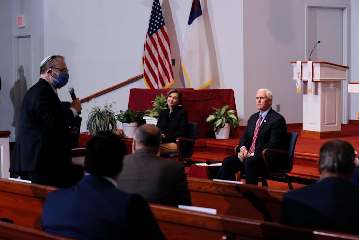 Vice President Mike Pence listens to a question from Temple B'nai Jeshurun Rabbi David Kaufman, left, during a discussion with local faith leaders to encourage them to resume in-person church services in a responsible fashion in response to the coronavirus pandemic on Friday.