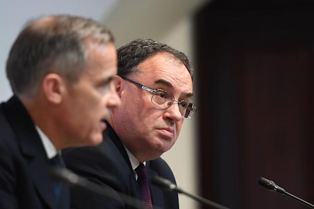 Bank of England governor Andrew Bailey, right, at a news conference in March. (Peter Summers/WPA Pool/Getty Images)