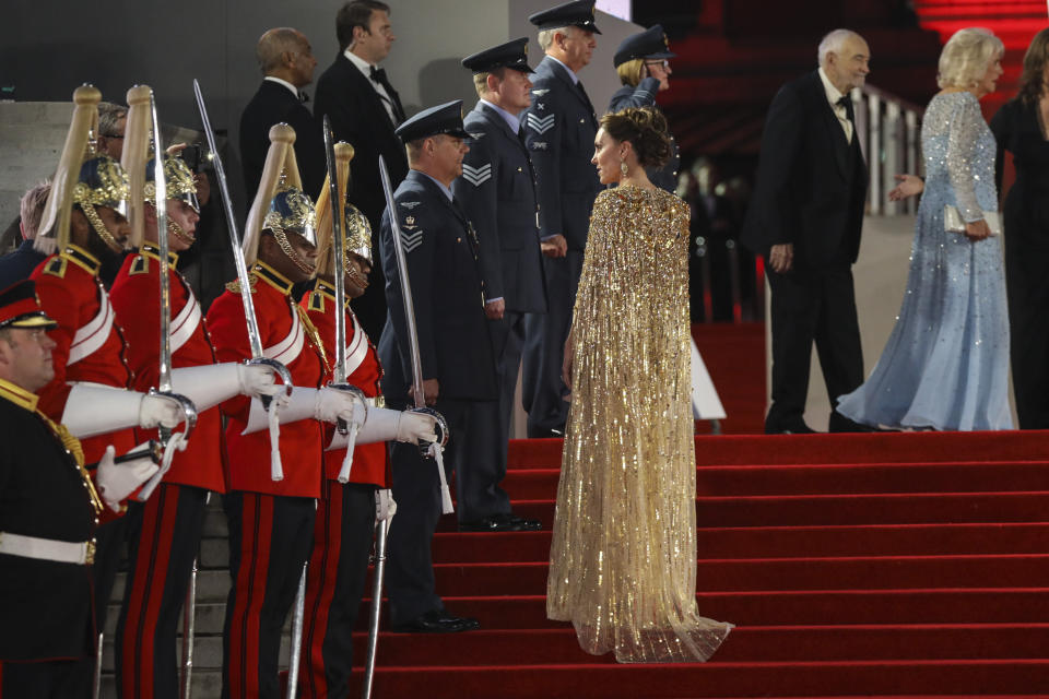 Kate the Duchess of Cambridge speaks with a member of the military upon arrival for the World premiere of the new film from the James Bond franchise 'No Time To Die', in London Tuesday, Sept. 28, 2021. (Photo by Vianney Le Caer/Invision/AP)