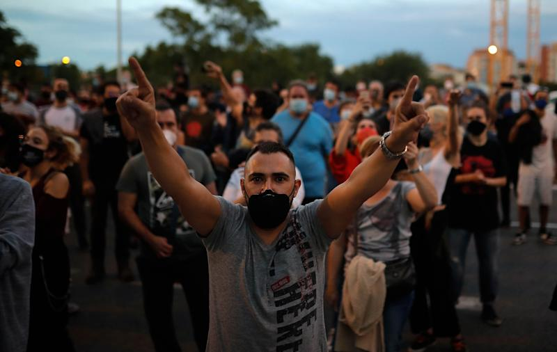 Protesters take part in a demonstration in the Vallecas neighborhood of Madrid against measures imposed by the Madrid regional government on areas with the most COVID-19 cases on Sept. 20. (Photo: Anadolu Agency via Getty Images)