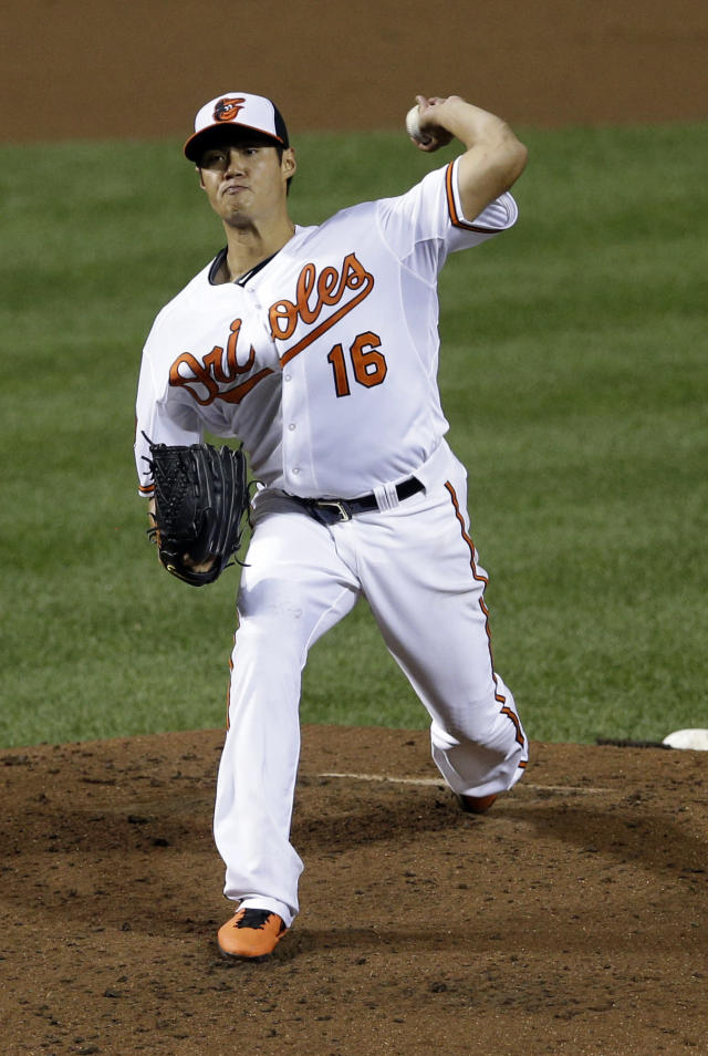 Baltimore Orioles starting pitcher Wei-Yin Chen, of Taiwan, throws to a New York Yankees in the third inning of a baseball game, Thursday, Sept. 12, 2013, in Baltimore. (AP Photo/Patrick Semansky)
