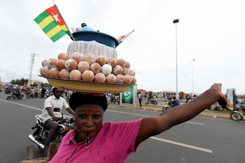 A vendors sells goods during an anti-government protest led by a coalition of opposition parties on September 7, 2017 in Lome (AFP Photo/PIUS UTOMI EKPEI)