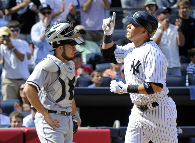 New York Yankees' Carlos Beltran, right, reacts as he comes home after hitting a home run while Chicago White Sox catcher Adrian Nieto, left, looks on during the sixth inning of a baseball game Saturday, Aug. 23, 2014, at Yankee Stadium in New York. The Yankees won 5-3. (AP Photo/Bill Kostroun)