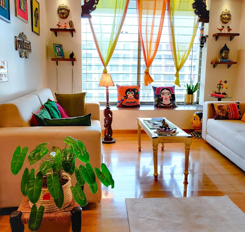 """""""Though I always wanted a bungalow with a big garden, my husband always wanted a small apartment. When I saw this apartment with huge french windows and two balconies where all my plants would fit, I happily agreed,"""" says Bhakti of her 3BHK home in Nashik."""