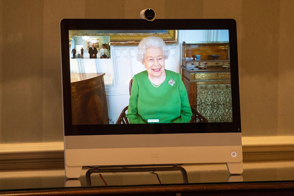 LONDON, ENGLAND - DECEMBER 18: Queen Elizabeth II appears on a screen by videolink from Windsor Castle, where she is in residence, during a virtual audience to receive Ambassador of Belgium Bruno van der Pluijm and Hildegarde Van de Voorde who attended at Buckingham Palace on December 18, 2020 in London, England. (Photo by Dominic Lipinski-WPA Pool/Getty Images)