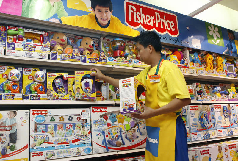 FILE PHOTO: An employee arranges Fisher-Price toys at a store in Manila's Makati financial district