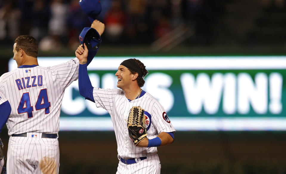 Chicago Cubs' Anthony Rizzo, left, and Albert Almora Jr. celebrate the team's 7-4 win against the New York Mets in a baseball game Thursday, June 20, 2019, in Chicago. (AP Photo/Jim Young)