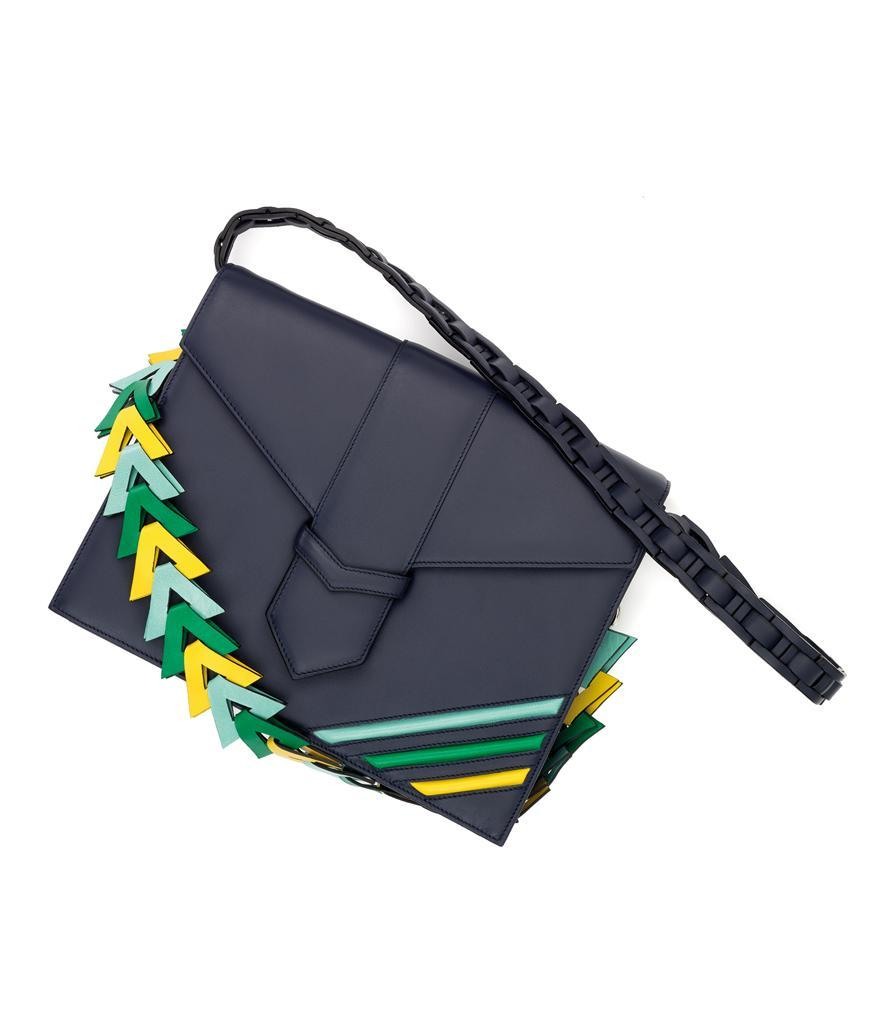 """<p>Loewe V Refined Calf Skin Clutch in Navy Blue, $2,450,<a href=""""http://thewebstermiami.com/"""" rel=""""nofollow noopener"""" target=""""_blank"""" data-ylk=""""slk:thewebstermiami.com"""" class=""""link rapid-noclick-resp""""> thewebstermiami.com</a><br><br></p>"""