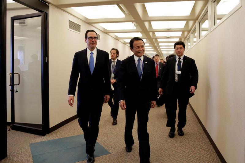 U.S. Treasury Secretary Steven Mnuchin and Japanese Finance Minister Taro Aso walk after their meeting during the IMF/World Bank spring meetings in Washington