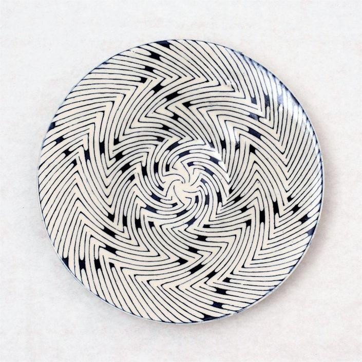 """This swirly serving tray, handmade in Zimbabwe, will make a statement in the new dining room. $245, 54Kibo. <a href=""""https://54kibo.com/collections/ceramics/products/binga-serving-platter-medium-12-inch"""" rel=""""nofollow noopener"""" target=""""_blank"""" data-ylk=""""slk:Get it now!"""" class=""""link rapid-noclick-resp"""">Get it now!</a>"""