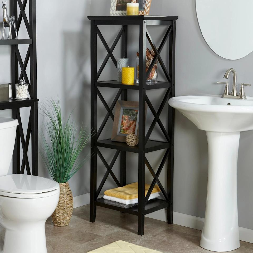 """<p>This <a href=""""https://www.popsugar.com/buy/X-Frame-Collection-4-Shelf-Storage-Tower-472156?p_name=X-Frame%20Collection%204-Shelf%20Storage%20Tower&retailer=target.com&pid=472156&price=106&evar1=casa%3Aus&evar9=46417510&evar98=https%3A%2F%2Fwww.popsugar.com%2Fhome%2Fphoto-gallery%2F46417510%2Fimage%2F46419045%2FX-Frame-Collection-4-Shelf-Storage-Tower&list1=target%2Cfurniture%2Cbathrooms&prop13=api&pdata=1"""" rel=""""nofollow"""" data-shoppable-link=""""1"""" target=""""_blank"""" class=""""ga-track"""" data-ga-category=""""Related"""" data-ga-label=""""https://www.target.com/p/x-frame-collection-4-shelf-storage-tower-black-riverridge/-/A-17218054"""" data-ga-action=""""In-Line Links"""">X-Frame Collection 4-Shelf Storage Tower</a> ($106) is just as decorative as it is useful.</p>"""