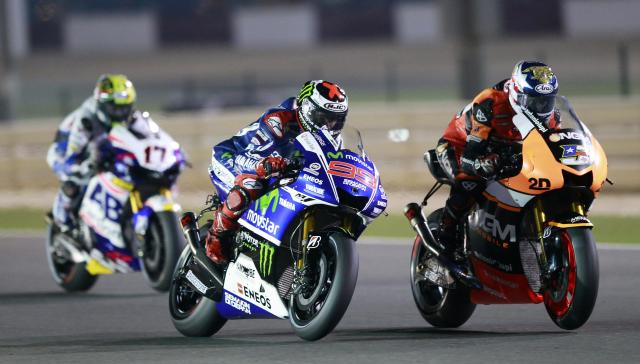 Yamaha MotoGP rider Jorge Lorenzo (C) of Spain rides his bike during a free practice session at the MotoGP World Championship at the Losail International circuit in Doha March 20, 2014. REUTERS/Mohammed Dabbous (QATAR - Tags: SPORT MOTORSPORT)
