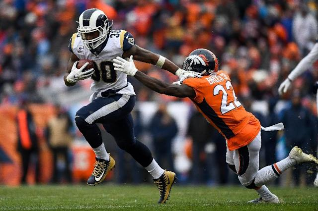 Todd Gurley, left, became the first Rams running back to rush for 200 yards and two touchdowns since Marshall Faulk in 2001. (AFP Photo/Dustin Bradford)