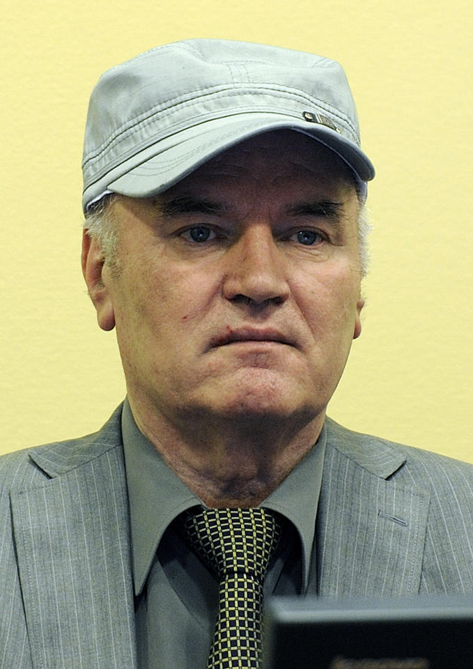 FILE - In this Friday, June 3, 2011 file photo former Bosnian Serb Gen. Ratko Mladic is seen as he sits in the court room during his initial appearance at the U.N.'s Yugoslav war crimes tribunal in The Hague, Netherlands. Twenty years after Serb forces unleashed a brutal campaign of ethnic cleansing in Bosnia, their military commander Gen. Ratko Mladic is finally going on trial Wednesday May 16, 2012, on charges of masterminding atrocities throughout the country's devastating 1992-95 war.(AP Photo/ Martin Meissner, Pool, File)