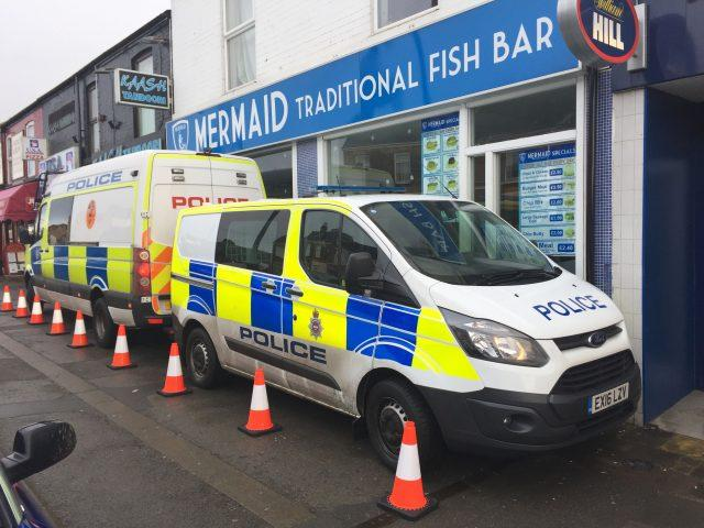 Police vans parked up outside a fish and chip shop in Chesterfield (Josh Payne/PA)