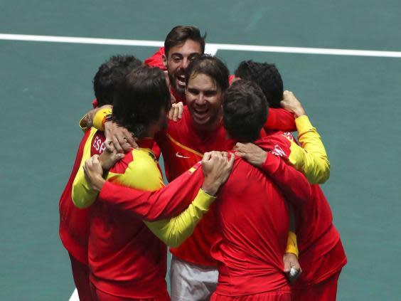 Nadal is joined by teammates after victory (EPA)