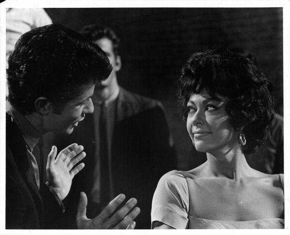 <p>Amid diamonds and pearls, don't forget about Rita Moreno's classic gold hoop earrings in <em>West Side Story</em>. The actress paired them with her square neck dress when she played Anita in the 1961 film. </p>