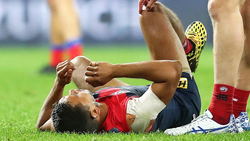 Neville Jetta is pictured lying on the ground after a heavy bump from Daniel McStay.