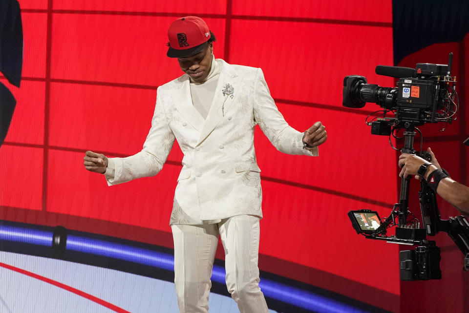 Scottie Barnes reacts after being selected fourth overall by the Toronto Raptors during the first round of the NBA basketball draft, Thursday, July 29, 2021, in New York. - Credit: AP
