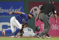 Seattle Mariners' Mallex Smith steals second base as Texas Rangers second baseman Rougned Odor applies a late tag in the fifth inning of a baseball game Thursday, Aug. 29, 2019, in Arlington, Texas. (AP Photo/Louis DeLuca)