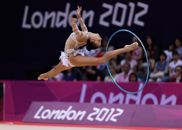 LONDON, ENGLAND - AUGUST 09: Daria Dmitrieva of Russia performs with the hoop during the Rhythmic Gymnastics qualification on Day 13 of the London 2012 Olympics Games at Wembley Arena on August 9, 2012 in London, England. (Photo by Julian Finney/Getty Images)