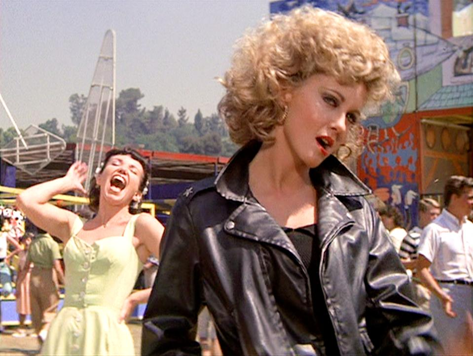"LOS ANGELES - JUNE 16: The movie ""Grease"", directed by Randal Kleiser. Seen here from left, Jamie Donnelly as Jan and Olivia Newton-John (in foreground, wearing tight black) as Sandy.  Initial theatrical release of the film, June 16, 1978. Screen capture. Paramount Pictures. (Photo by CBS via Getty Images)"